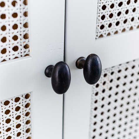 The solid iron door knobs finished in natural beeswax will last a lifetime.