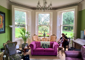 Cellist in the Manor Living Room