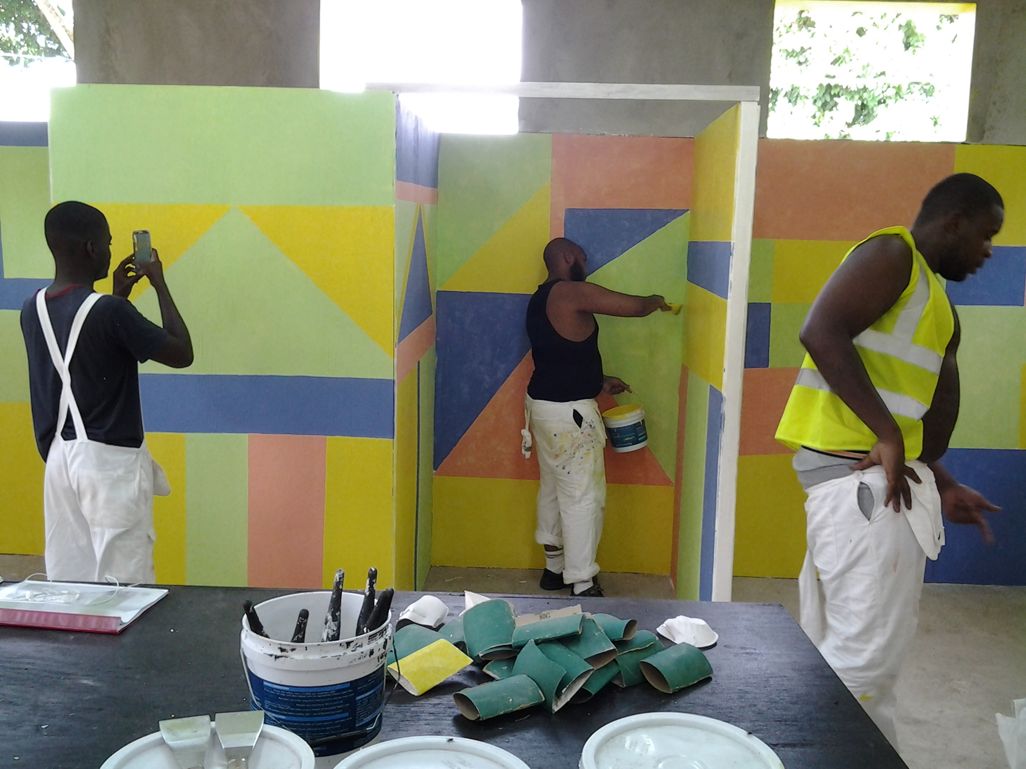 3 males/boys painting