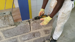 1 male_boy leveling the bricks