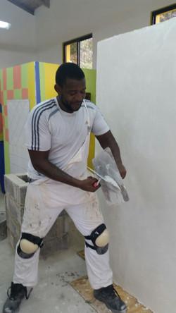 1 male/boy plastering