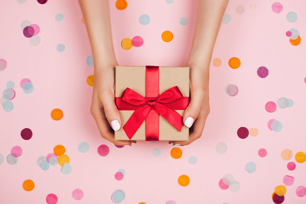 Woman hands holding present box with red
