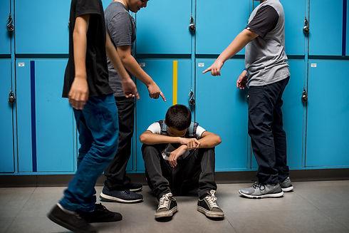 Boy student getting bullied in school.jp