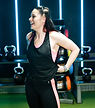 Online coach and London personal trainer Beth Lavis Fitness smiling in the gym during a workout.