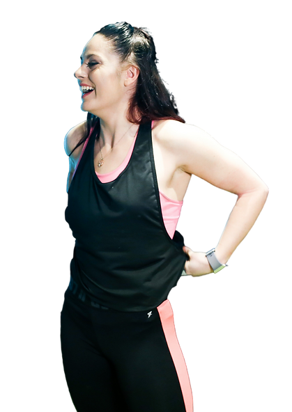 Beth Lavis, Online Coach and Personal Trainer in London smiling in the gym.png