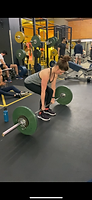 Picture of one to one coaching client of Beth Lavis Fitness about to perform a barbell deadlift