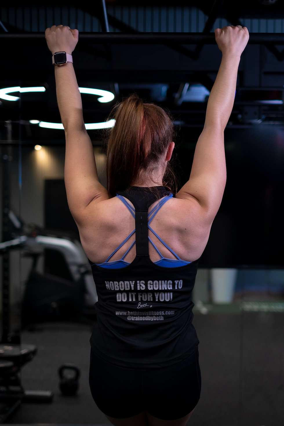 Personal trainer doing a pull-up