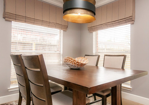 Dining room with a custom window treatment