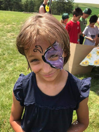 Face painting at Sunflower Festival