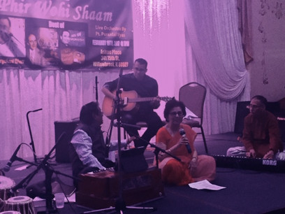 Mani singing with visiting artist from India.