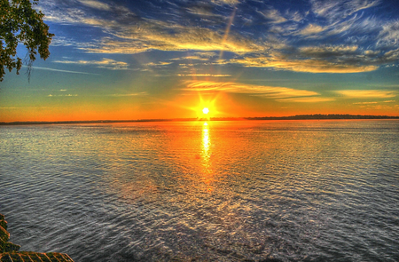 Sunrise over water.png