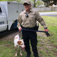 Officer Tedford is seen here with one of the many dogs we help within the community.