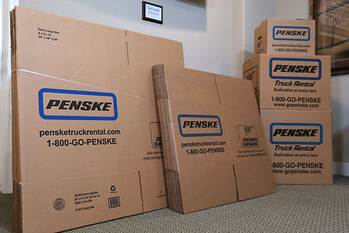 Pictured: Stacks of cardboard Penske moving boxes in the office at The Venice Storage Co.