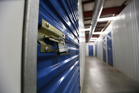 Pictured: A close-up of a padlock securely locking an indoor storage unit at The Venice Storage Co.