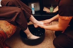 thai-man-washing-feet-legs-making-classical-thai-massage-procedure-young-woman-beauty-spa-