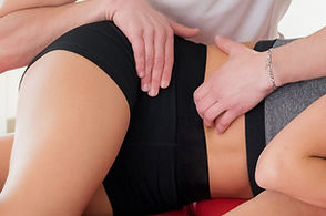 osteopath-performing-sacroiliac-myofascial-massage-young-woman-manipulating-muscles-her-sa