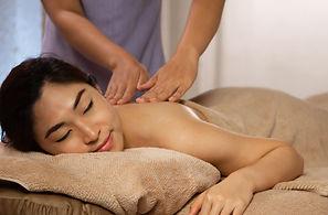 masseuse-doing-massage-asian-female-body-spa-salon.jpg