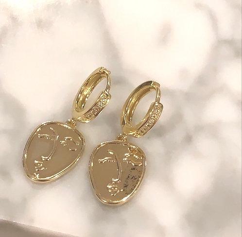 GIRL IN GOLD EARRINGS