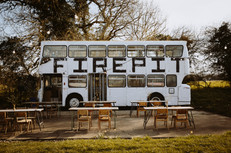 The Fire Pit Camp Double Decker Bus by Ali Dover