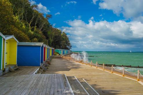 Colourful beach huts along Totland beach