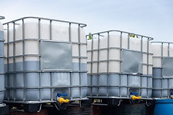 white ibc container in outdoor stock yar