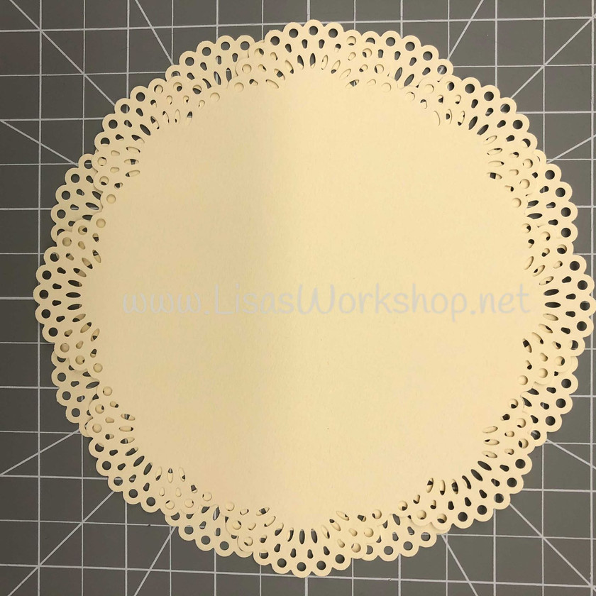 Layer the 2 circles on top of each other, ofsetting so the scalloped edges alternate.