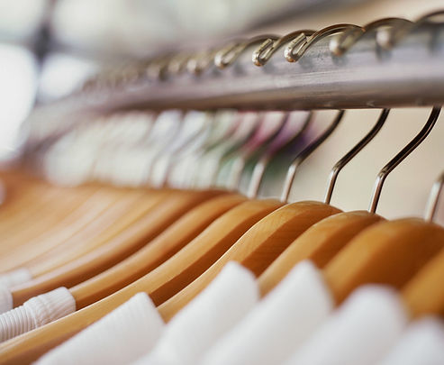 rack of white clothes on hangars