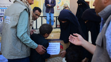 Malnourished children receive food supplies in Sana'a from Mona Relief for the second round