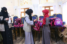 150 orphan girl students received school backpacks in Sana'a from Mona Relief