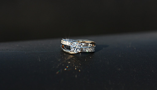 Yellow and white, two-tone, 14k gold diamond ring with each prong a different color to represent two individuals coming together for one purpose.
