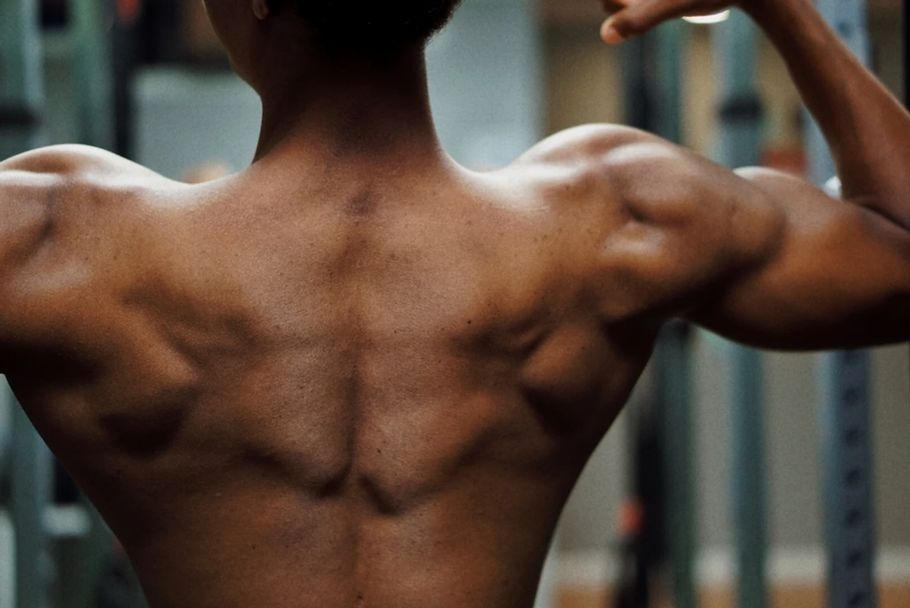 Man flexing his back muscles.
