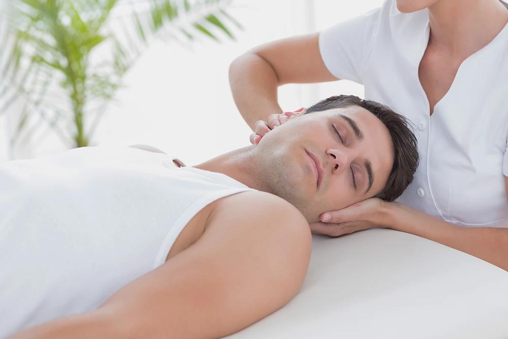 Man receiving a chiropractic neck adjustment.