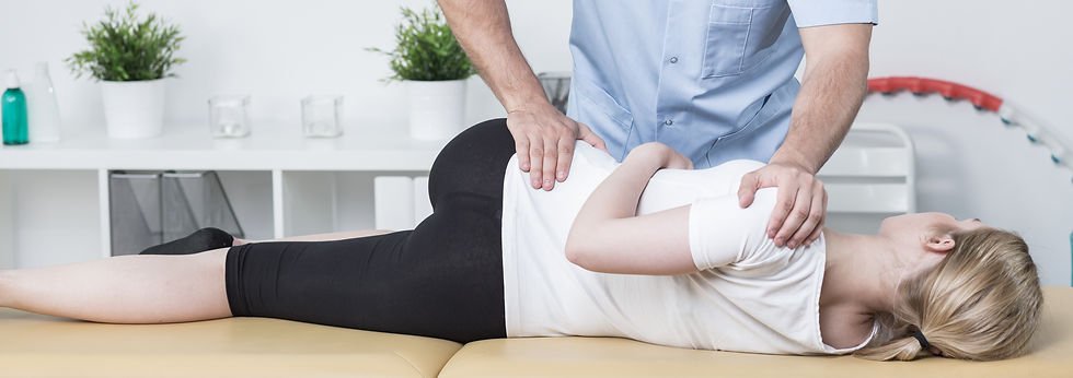 A chiropractor in Pittsburgh performs a chiropractic adjustment to relieve the patient's lower back pain.