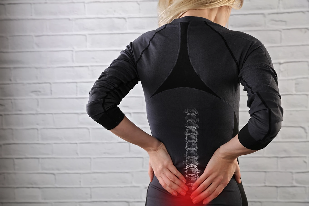 Woman experiencing Vertebral Subluxation in need of Chiropractic Services in Pittsburgh