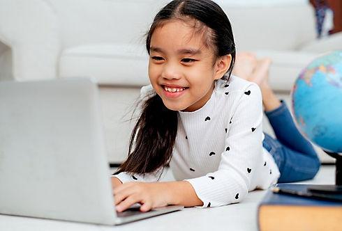 bigstock-happy-asian-girl-using-laptop-3