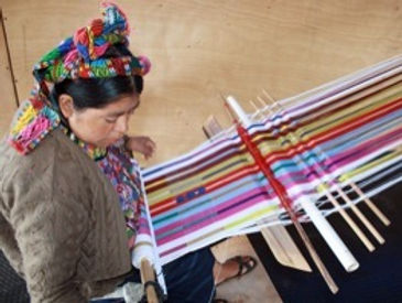The women of Cajola furnishing their works.
