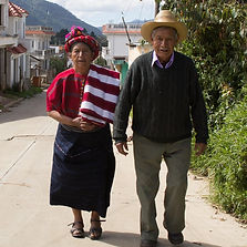 A Guatemalan couple strolling around the streets to get home.