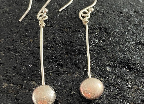 Full stop dangle earrings