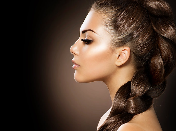 Hair Braid. Beautiful Woman with Healthy Long Hair. Hairdressing. Hairstyle. Beauty Glamour Fashion