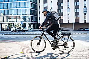 Male courier with bicycle delivering pac
