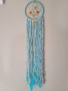 """4"""" mini on metal hoop wrapped in yarn, knotted web, ribbons, beads and feathers. $15"""