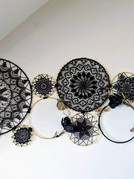 Custom large collage for Wedding backdrop - Gold metal hoops of various sizes, black doilies provided by customer, faux flowers and black yarn.