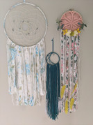 """10"""" metal hoop wrapped in fabric, yarns, beads & feathers. 4"""" mine metal hoop crescent moon with beads, ribbon, feathers and yarn. 6"""" wood hoop with vintage doily, ribbons, yarns faux flowersand eucalyptus $20."""