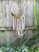 """19"""" metal hoop wrapped with ribbons, half vintage doily & half web, custom wood slice, ribbons, faux succulents & feathers. $65 + shipping"""