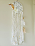 """8"""" wood hoop with vintage doily, ribbons, yarns, beads and feathers"""