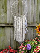 """19"""" metal hoop wrapped with yarn, crescent moon knotted web, yarns, ribbons, feathers and chakra beads $65"""