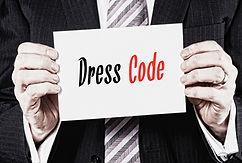 Man-holding-a-card-with-dress-code-written-on-it.jpg