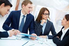 male-executive-holding-blue-folder-meeting.jpg