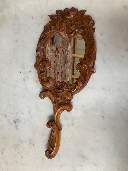 Joli miroir à main sculpté