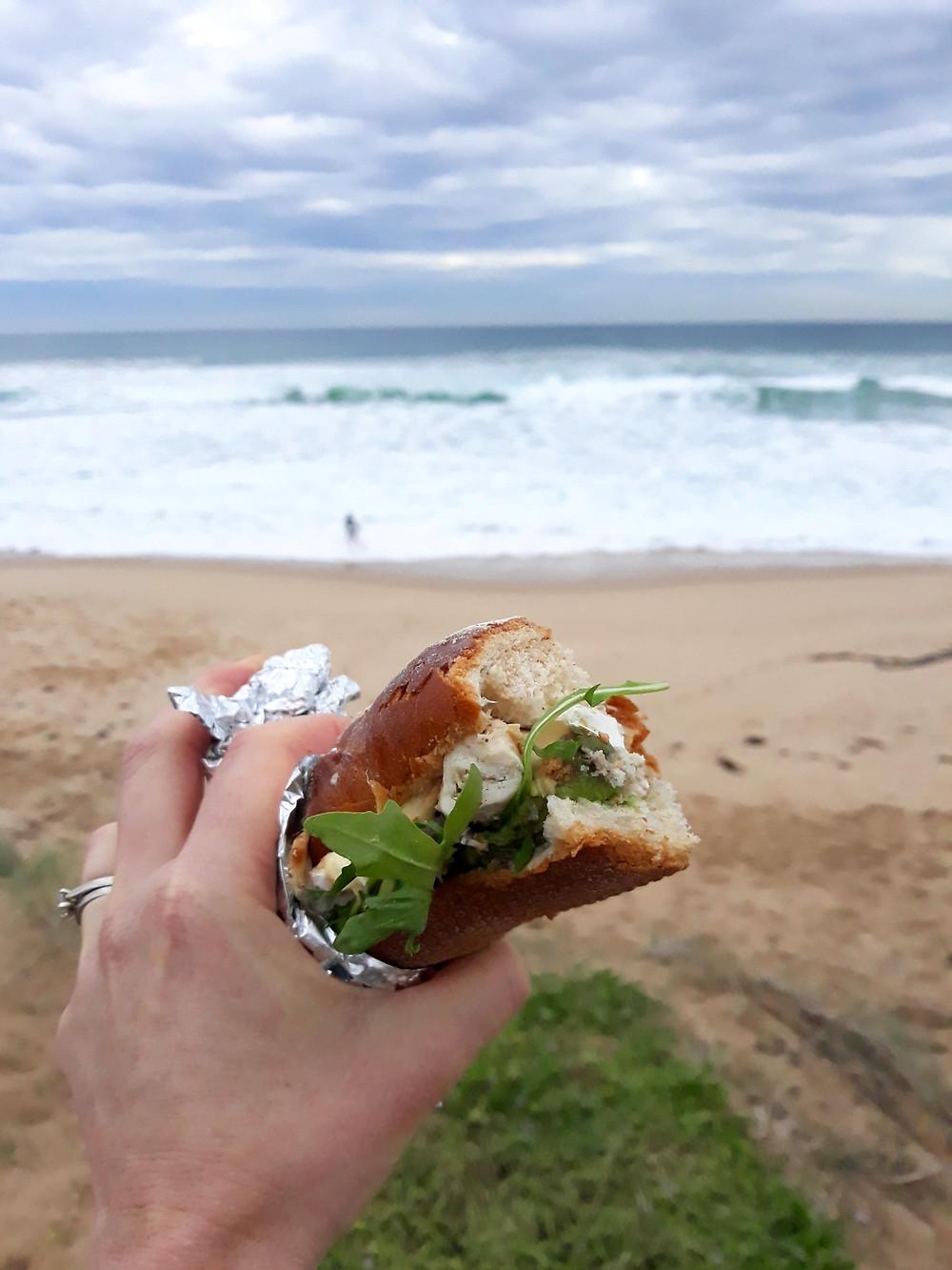 Watching surfers enjoying a sourdough baguette!